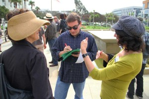 Daily Press Editor-in-Chief Kevin Herrera conducting interviews outside City Hall earlier this month. (Daniel Archuleta daniela@smdp.com)