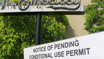 POSTED: A notice regarding a proposed conditional use permit is displayed in front of Palihouse. (File photo)