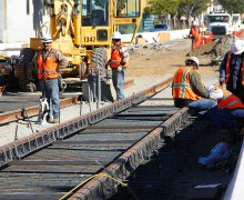 Works install train tracks along Colorado Avenue last month. (File photo)