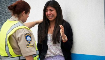 A Santa Monica College student cries following the shootings on campus last year. (File photo)