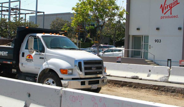 WORKING IT: Virgin Produced is among the businesses impacted by noise related to construction of the Expo Light Rail Line along Colorado Avenue. So far, they say it isn't a bother. (Daniel Archuleta daniela@smdp.com)