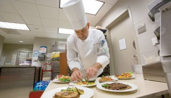 Gabriel Gomez, executive chef, prepares antibiotic-free menu items at Ronald Reagan UCLA Medical Center.