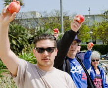 Apples were held up Sunday at City Hall on behalf of Mark Black, a teacher that was placed on leave following an altercation with a pair of Santa Monica High students. (Paul Alvarez Jr. editor@smdp.com)