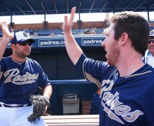 Cody Decker (left) gives a teammate a high five during spring training.                           (Photo courtesy San Diego Padres)
