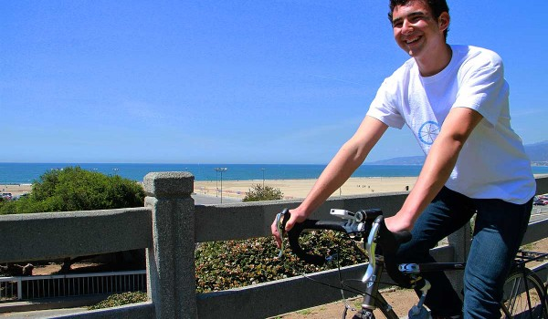 ROLLING: Benji Miller rides his bike through Palisades Park while listening to his invention, the Allo smartphone speaker. (Daniel Archuleta daniela@smdp.com)