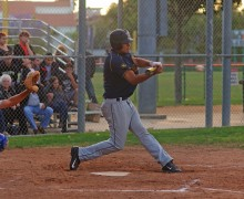 BIG CUT: Santa Monica's Rudy Olmedo swings at a pitch against Beverly Hills on Tuesday at La Cienega Park. (Morgan Genser editor@smdp.com)