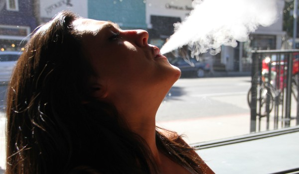 Brittany O'Boyle, an employee at FIX Vapor on Main Street, enjoys a mid-day vapor session. (Daniel Archuleta)