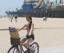 A woman rides along the beach bike path on Tuesday. (Daniel Archuleta)