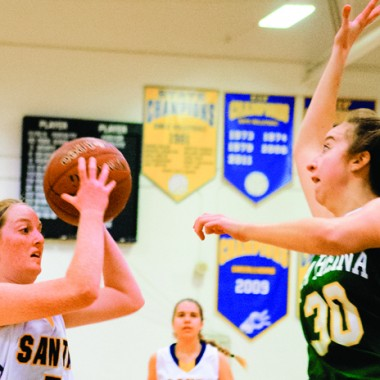 Left Olivia Feffer from the Santa Monica High School girls basketball team goes for a layup as Helene Alex from the La Reina girls basketball team gets back and prepares to block the layup attempt inside the north gym located on the campus of Santa Monica High School on Thursday night January 8th 2015 as SAMO hosted La-Reina in a non-leage basketball game and lost 50-40 dropping their record there record to 4-7 on the year.